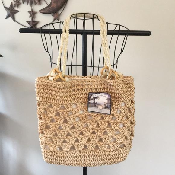jordan escapes Handbags - NWT Unique corn husk purse.